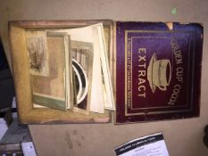 A wooden box containing old / antique pictures.