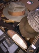 A box of vintage shoes and 3 hats