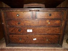A wooden 5 drawer tool cabinet