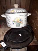 A metal cooking pot and 2 cast metal skillets