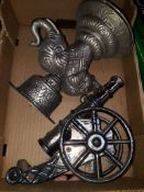 Box containing metal elephant and cannon