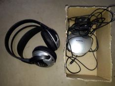 A set of Panasonic stereo headphones with chargng dock