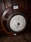 A fisherman's aneroid barometer by Dolland, mounted on ships wheel