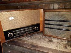 A Defiant vintage radio with separate speaker