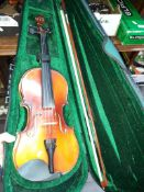 A violin in a case with a bow