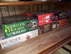 6 boxes of Murder Mystery games