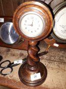 An oak clock on a twist stem