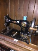 A hand cranked CWS Family sewing machine