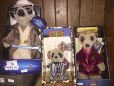 Three meerkat soft toys, boxed and with paperwork, including Safari Oleg, Aleksander, and limited