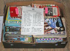 A box of football programmes.