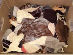 A box of leather off cuts.