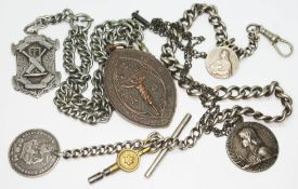 A hallmarked silver Albert chain with coin fob, a white metal Albert chain with hallmarked silver