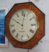 """A 19th century bird's eye maple octagonal wall clock, the 12"""" dial painted with Roman Numerals and"""