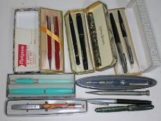 A quantity of vintage pens and pencils including two fountain pens with nibs marked 14ct.