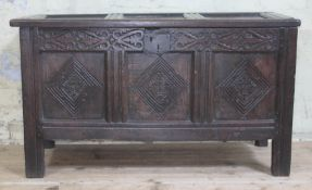 A 17th century carved and panelled joined oak coffer, length 107.5cm, depth 45cm & height 62cm.