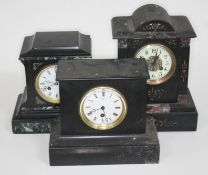 A group of three black slate/marble mantle clocks, height 21cm to 31cm.