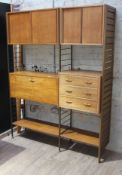 A Staples Ladderax bookcase comprising two metal ladders and one wooden ladder, two cabinets with