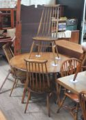 An Ercol Golden Dawn drop leaf table and five chairs. Condition - very good, minor wear only.