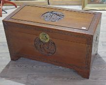 A good quality Chinese shipping chest, circa 1930s, of typical form with carved exterior and camphor