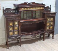 An Edwardian Art Nouveau mahogany cabinet of stepped form with broken scroll pediment, pierced