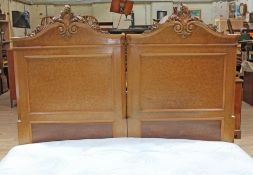 A continental birds eye maple double bed circa 1900, the heads with carved scrolls, with super