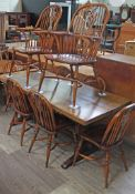 A Batheaston reproduction oak refectory table with eight ash and elm seated chairs comprising a