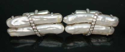 A pair of elongated pearl and diamond cufflinks, length 39mm each, crafted in white metal, unmarked,