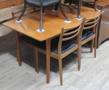 A McIntosh teak extending dining table matched with four G-Plan chairs.