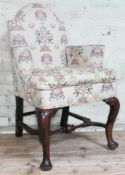 An 18th century and later oak armchair of small proportions with domed back, scroll arms and