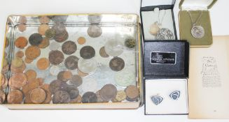 A mixed lot comprising various coins, two silver St Christopher medallions, a pair of Peter