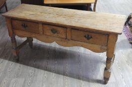 A 19th century three drawer pine dresser base, width 149cm, depth 49cm & height 74cm.
