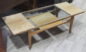 A G-Plan teak coffee table with glass insert and lower tier, length 137cm.