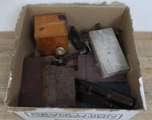 A box containing microscope books, two boxed microscopes, a bakelite microscope and various slide