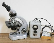 A Carl Zeiss electric microscope with additional slides and transformer.