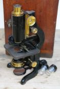 A boxed microscope by Watson & Glover opticians, 2 easy row, Birmingham.
