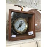 A cased ships clock