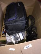 A box of mainly camera related items to include a 1960s slide projector, a cca 1960s Kodak camera, a