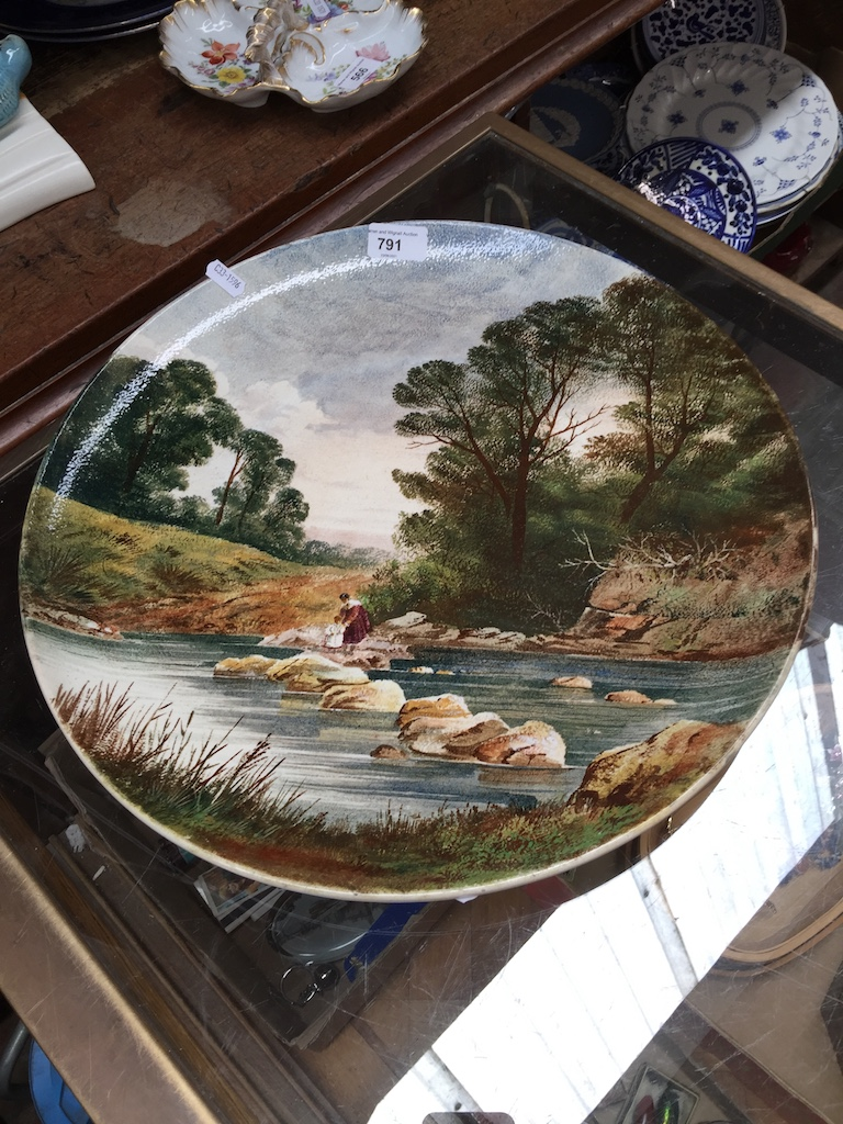 A Wedgwood charger 42cm diameter, c1883, hand painted after Birkett Foster