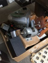 A box of various scientific equipment including a light sensor, scalamp galvanometer, a smoothing