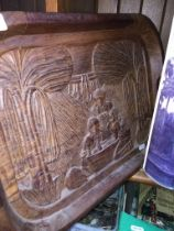 An African carved wooden tray