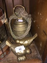 A brass bell on rope and a pair of gilded cast metal birds