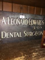 A metal dentist's sign.