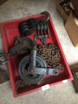 A half tonne chain block and 3 chain pulleys.