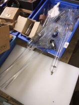 A box of scientific glassware and few valves.