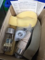 A box containing 3 photo multiplier tubes.