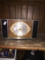 A vintage Metamec clock - in working order.