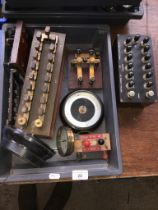 A box of Wheatstone bridges and galvanometers.