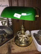 A brass desk lamp