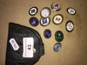 A collection of golf markers