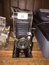 Agfa folding camera with case.